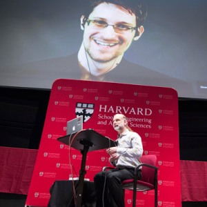 "Former NSA systems administrator Edward Snowden called in from Moscow via video chat for a conversation with Berkman Fellow Bruce Schneier during a symposium on ""Privacy in a Networked World"" at Harvard SEAS. (Photo by Scott Eisen, courtesy of Harvard IACS.)"